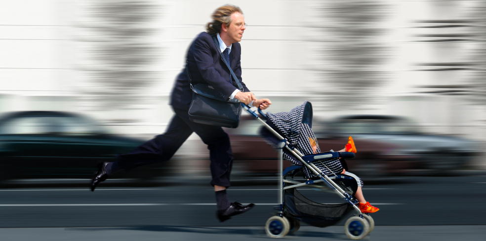 Businessman running with stroller