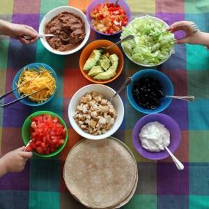 Kids choosing burrito fillings